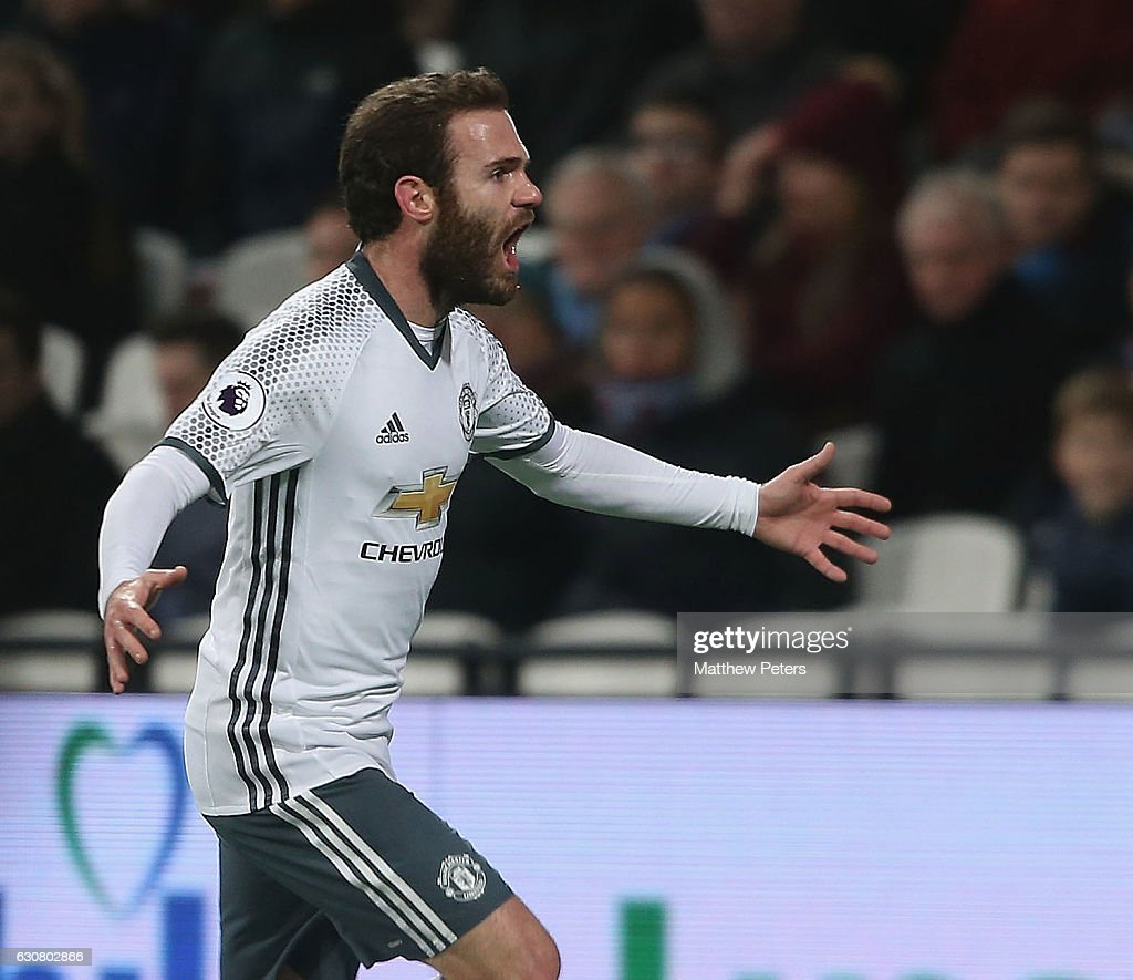 Juan Mata of Manchester United celebrates scoring their first goal during the Premier League match between West Ham United and Manchester United at London Stadium on January 2, 2017 in Stratford, England.