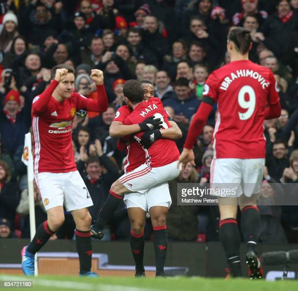 Juan Mata of Manchester United celebrates scoring their first goal during the Premier League match between Manchester United and Watford at Old...