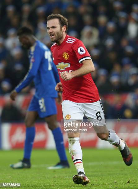 Juan Mata of Manchester United celebrates scoring their first goal during the Premier League match between Leicester City and Manchester United at...