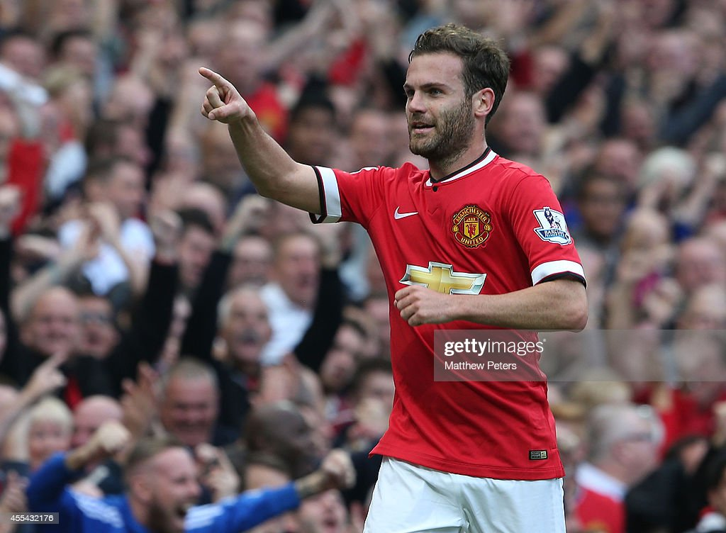Juan Mata of Manchester United celebrates scoring their fourth goal during the Barclays Premier League match between Manchester United and Queens Park Rangers at Old Trafford on September 14, 2014 in Manchester, England.