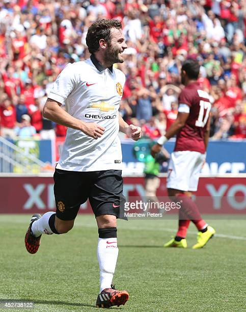 Juan Mata of Manchester United celebrates scoring their second goal during the pre-season friendly match between Manchester United and AS Roma at...