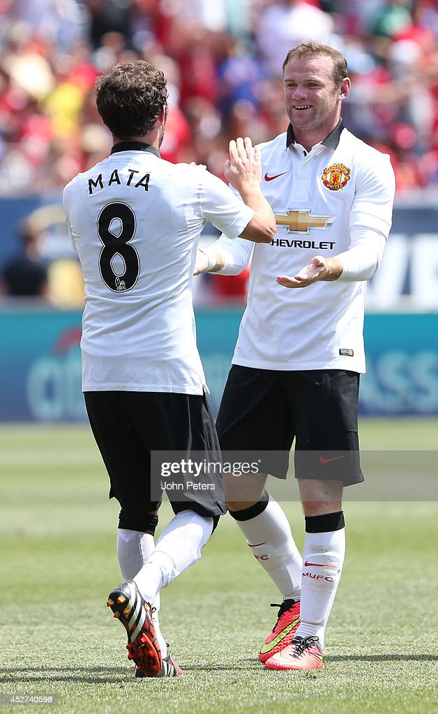 Juan Mata of Manchester United celebrates scoring their second goal during the pre-season friendly match between Manchester United and AS Roma at Sports Authority Field at Mile High on July 26, 2014 in Denver, Colorado.