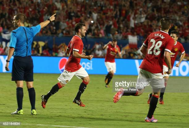 Juan Mata of Manchester United celebrates scoring their second goal during the preseason friendly match between Manchester United and Liverpool at...