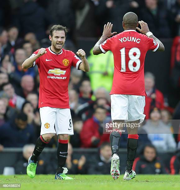 Juan Mata of Manchester United celebrates scoring their second goal during the Barclays Premier League match between Manchester United and Liverpool...