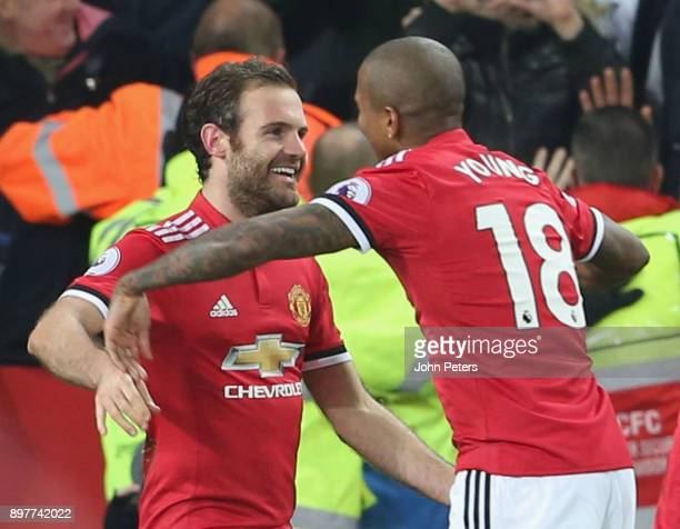 Juan Mata of Manchester United celebrates scoring their second goal during the Premier League match between Leicester City and Manchester United at...