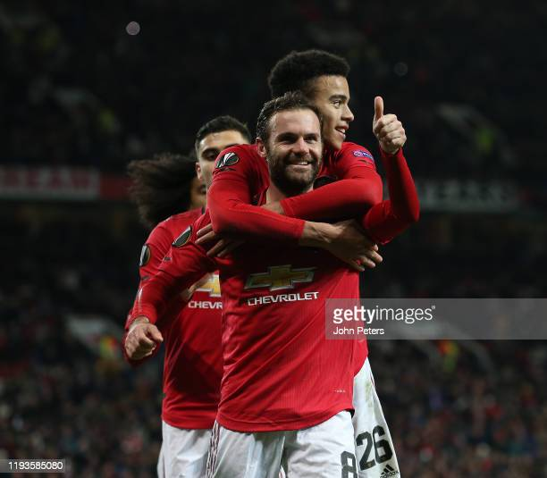 Juan Mata of Manchester United celebrates scoring their third goal during the UEFA Europa League group L match between Manchester United and AZ...