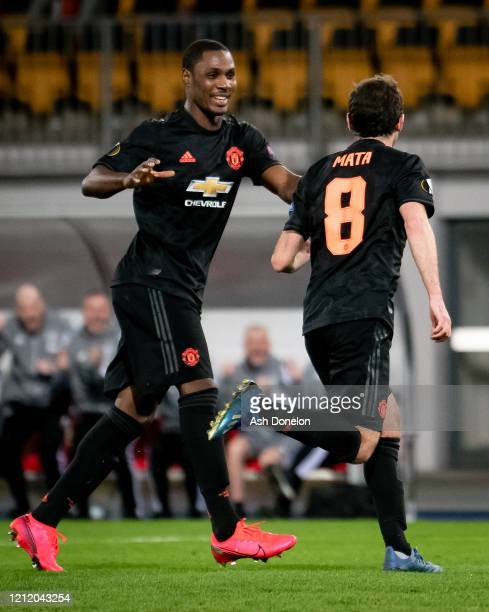 Juan Mata of Manchester United celebrates scoring their third goal during the UEFA Europa League round of 16 first leg match between LASK and...