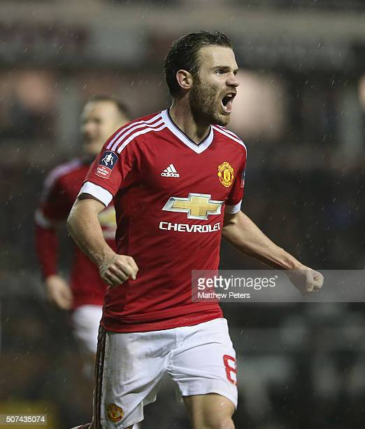 Juan Mata of Manchester United celebrates scoring their third goal during the Emirates FA Cup Fourth Round match between Derby County and Manchester...