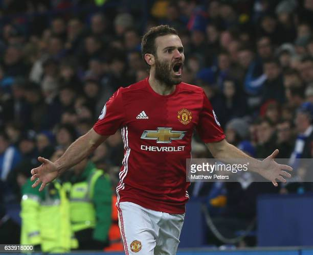 Juan Mata of Manchester United celebrates scoring their third goal during the Premier League match between Leicester City and Manchester United at...