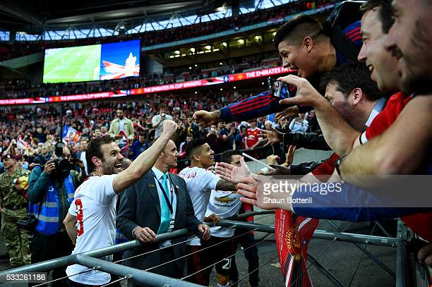 Juan Mata of Manchester United celebrates victory with the fans after The Emirates FA Cup Final match between Manchester United and Crystal Palace at...