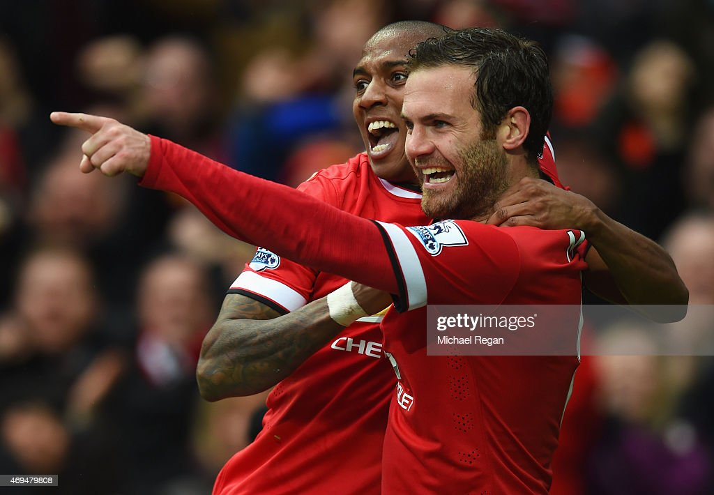 Juan Mata of Manchester United celebrates with Ashley Young as scores their third goal during the Barclays Premier League match between Manchester United and Manchester City at Old Trafford on April 12, 2015 in Manchester, England.