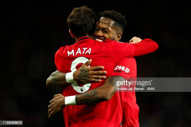 Juan Mata of Manchester United celebrates with Fred of Manchester United during the Premier League match between Manchester United and Norwich City...
