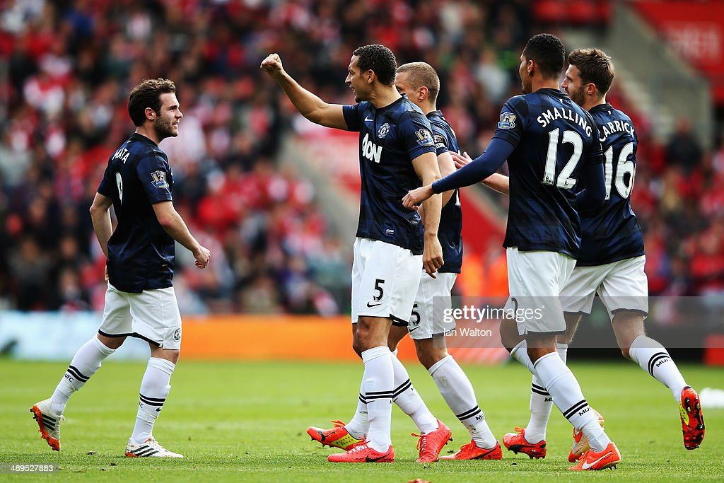 Juan Mata (L) of Manchester United celebrates with team mates after scoring during the Barclays Premier League match between Southampton and Manchester United at St Mary's Stadium on May 11, 2014 in Southampton, England.