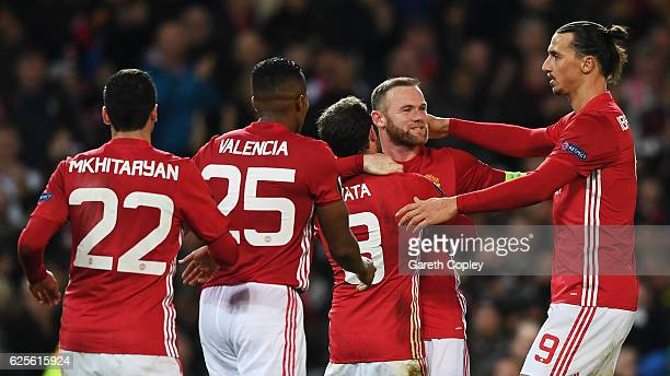 Juan Mata of Manchester United celebrates with team mates as he scores their second goal during the UEFA Europa League Group A match between...