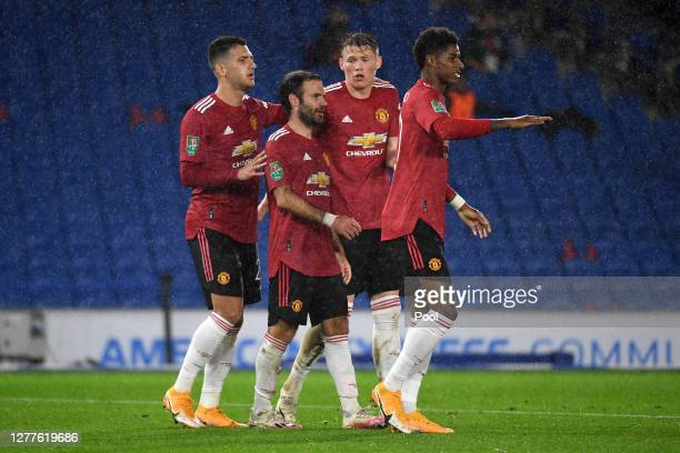 Juan Mata of Manchester United celebrates with teammates after scoring his sides second goal during the Carabao Cup fourth round match between...