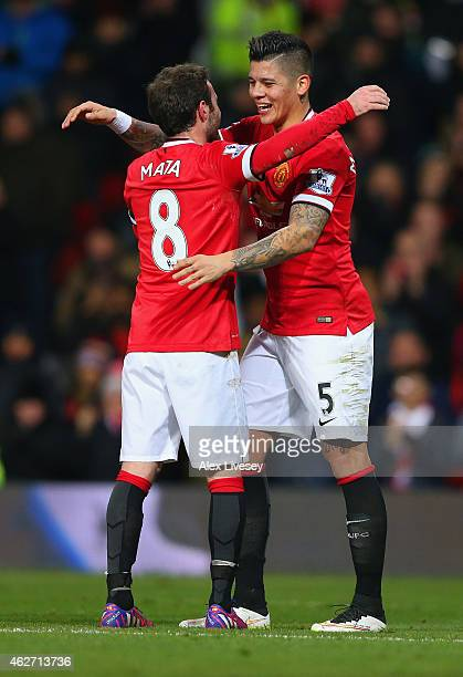 Juan Mata of Manchester United congratulates Marcos Rojo of Manchester United on scoring their second goal during the FA Cup Fourth round replay...