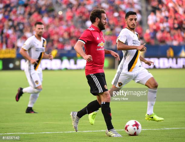 Juan Mata of Manchester United dribbles in on Hugo Arellano of Los Angeles Galaxy during the first half at StubHub Center on July 15 2017 in Carson...