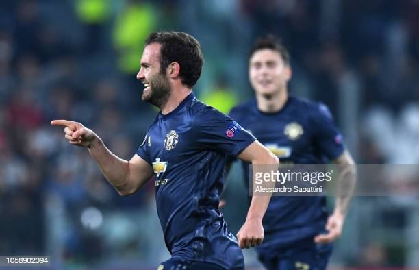 Juan Mata of Manchester United FC celebrates after scoring the 11 goal during the Group H match of the UEFA Champions League between Juventus and...