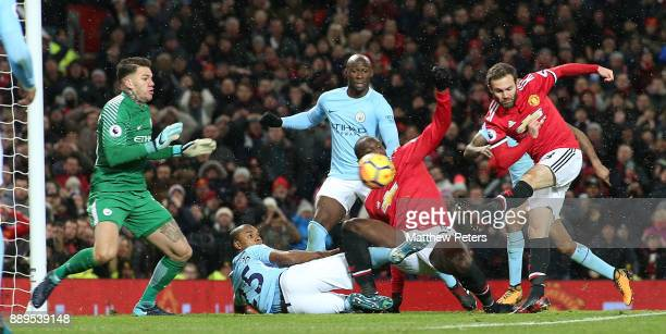 Juan Mata of Manchester United has a shot saved by Ederson of Manchester City during the Premier League match between Manchester United and...