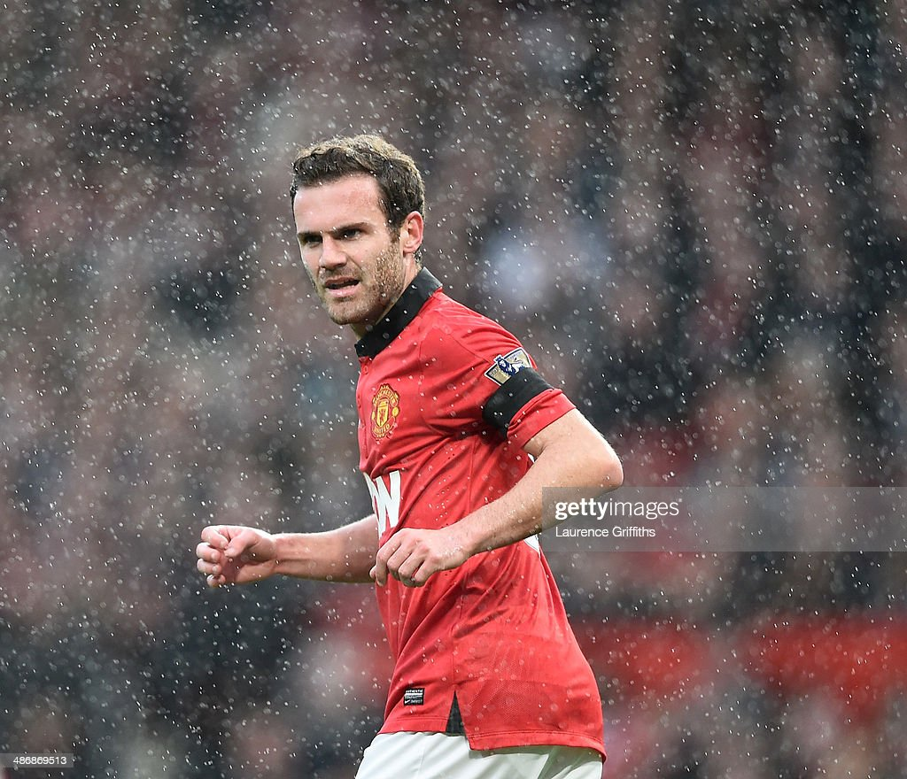Juan Mata of Manchester United in a rain during the Barclays Premier League match between Manchester United and Norwich City at Old Trafford on April 26, 2014 in Manchester, England.