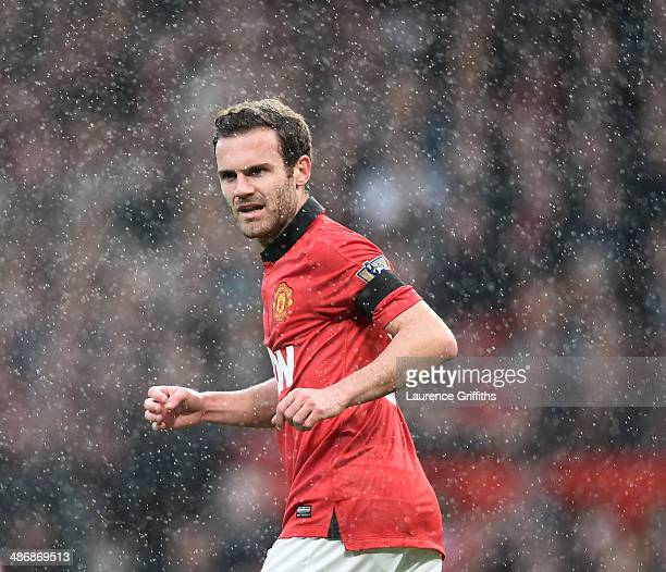 Juan Mata of Manchester United in a rain during the Barclays Premier League match between Manchester United and Norwich City at Old Trafford on April...