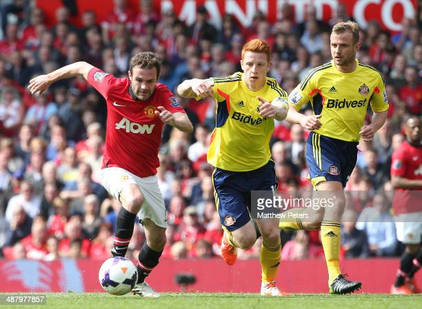 Juan Mata of Manchester United in action against Jack Colback of Sunderland during the Barclays Premier League match between Manchester United and...