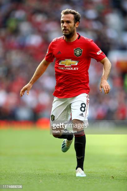 Juan Mata of Manchester United in action during the Premier League match between Manchester United and Leicester City at Old Trafford on September 14...