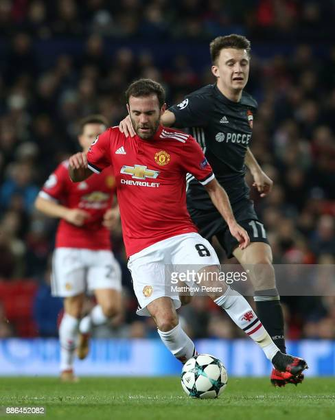 Juan Mata of Manchester United in action with Aleksandr Golovin of CSKA Moscow during the UEFA Champions League group A match between Manchester...