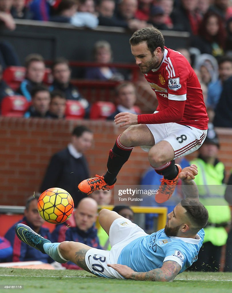 Juan Mata of Manchester United in action with Aleksandr Kolarov of Manchester City during the Barclays Premier League match between Manchester United and Manchester City at Old Trafford on October 25, 2015 in Manchester, England.