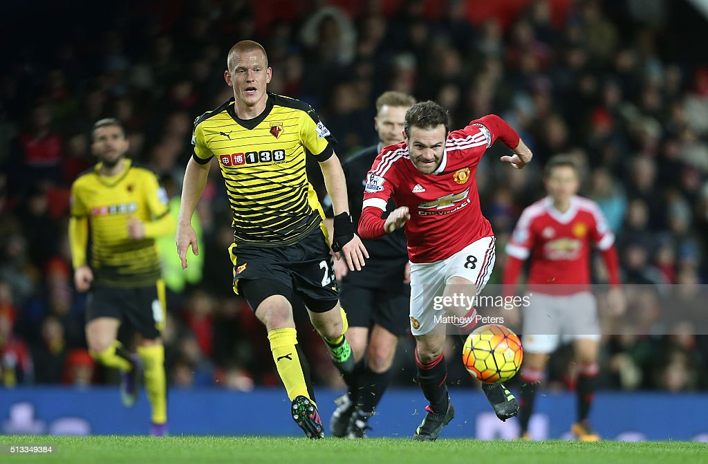 Juan Mata of Manchester United in action with Ben Watson of Watford during the Barclays Premier League match between Manchester United and Watford at Old Trafford on March 2, 2016 in Manchester, England.