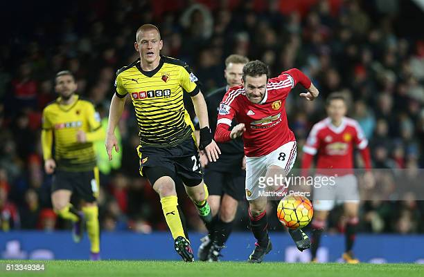 Juan Mata of Manchester United in action with Ben Watson of Watford during the Barclays Premier League match between Manchester United and Watford at...
