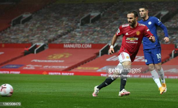 Juan Mata of Manchester United in action with Christian Pulisic of Chelsea during the Premier League match between Manchester United and Chelsea at...