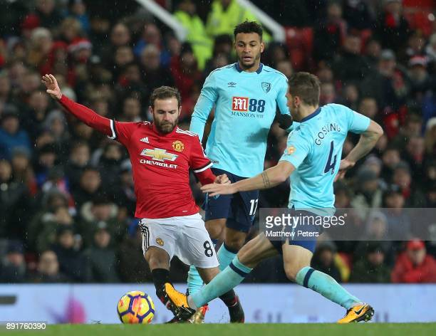 Juan Mata of Manchester United in action with Dan Gosling of AFC Bournemouth during the Premier League match between Manchester United and AFC...