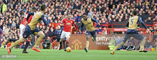 Juan Mata of Manchester United in action with Danny Welbeck of Arsenal during the Barclays Premier League match between Manchester United and Arsenal...