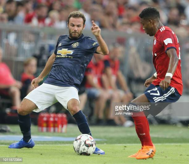Juan Mata of Manchester United in action with David Alaba of Bayern Munich during the preseason friendly match between Bayern Munich and Manchester...