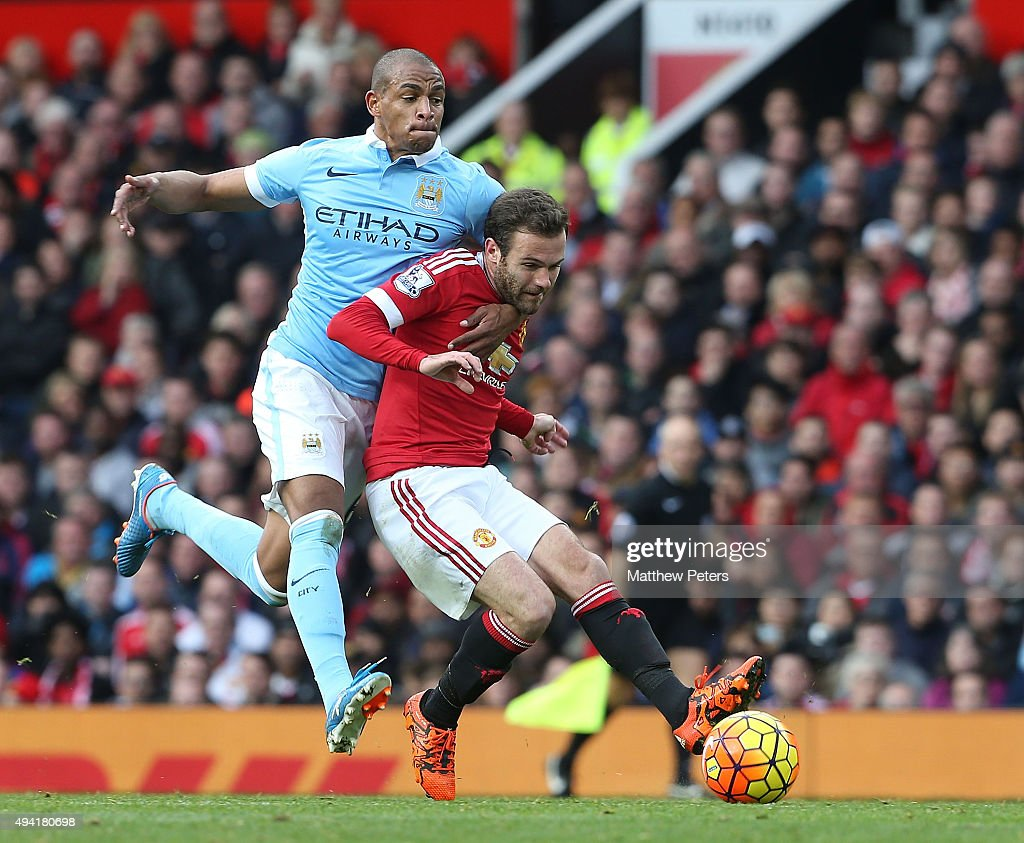 Juan Mata of Manchester United in action with Fernando of Manchester City during the Barclays Premier League match between Manchester United and Manchester City at Old Trafford on October 25, 2015 in Manchester, England.