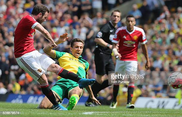 Juan Mata of Manchester United in action with Gary O'Neil of Norwich City during the Barclays Premier League match between Norwich City and...