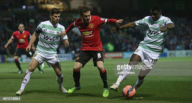 Juan Mata of Manchester United in action with Joe Edwards and Seth Twumasi of Yeovil Town during the FA Cup Third Round match between Yeovil Town and...