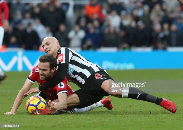 Juan Mata of Manchester United in action with Jonjo Shelvey of Newcastle United during the Premier League match between Newcastle United and...