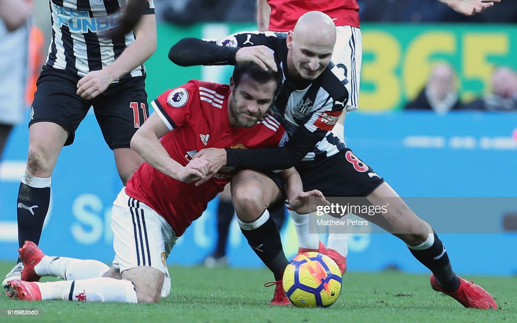 Juan Mata of Manchester United in action with Jonjo Shelvey of Newcastle United during the Premier League match between Newcastle United and Manchester United at St. James Park on February 11, 2018 in Newcastle upon Tyne, England.