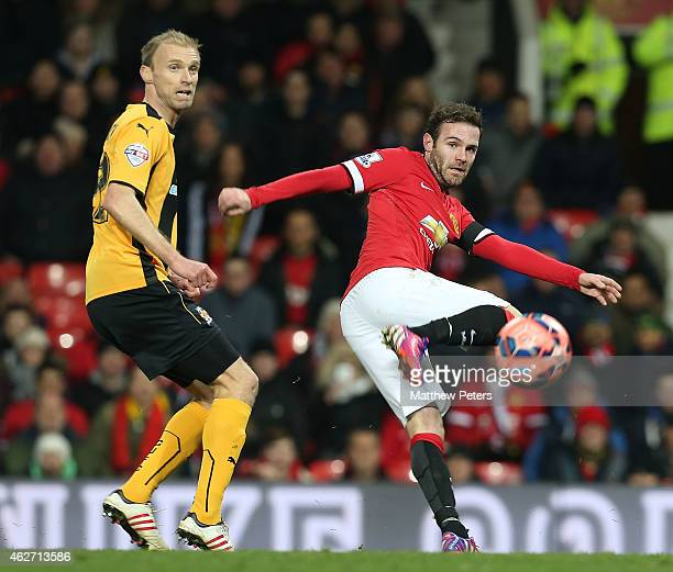 Juan Mata of Manchester United in action with Luke Chadwick of Cambridge United during the FA Cup Fourth Round replay match between Manchester United...
