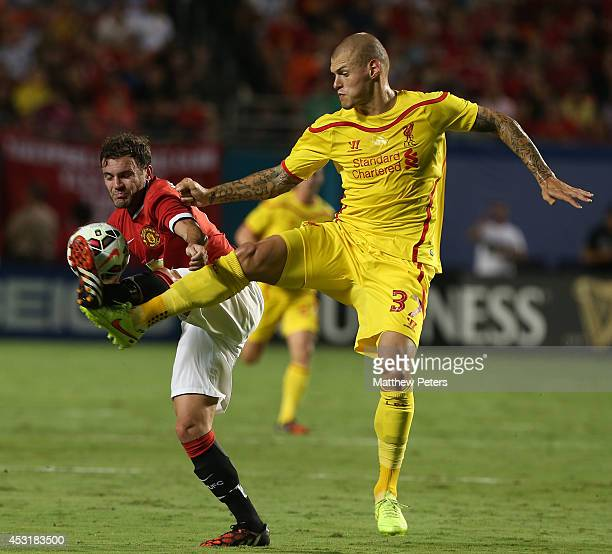 Juan Mata of Manchester United in action with Martin Skrtel of Liverpool during the preseason friendly match between Manchester United and Liverpool...