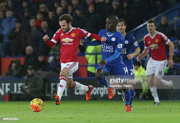 Juan Mata of Manchester United in action with Ngolo Kante of Leicester City during the Barclays Premier League match between Leicester City and...