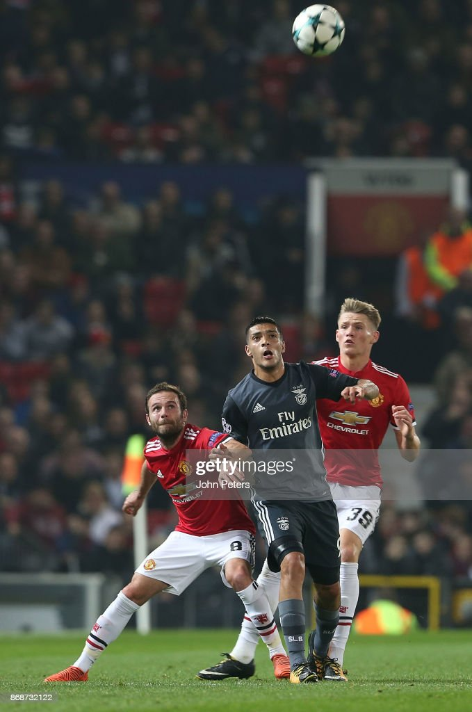 Juan Mata of Manchester United in action with Raul Jimenez of Benfica during the UEFA Champions League group A match between Manchester United and SL Benfica at Old Trafford on October 31, 2017 in Manchester, United Kingdom.