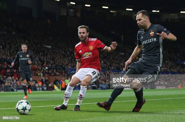 Juan Mata of Manchester United in action with Sergei Ignashevich of CSKA Moscow during the UEFA Champions League group A match between Manchester...