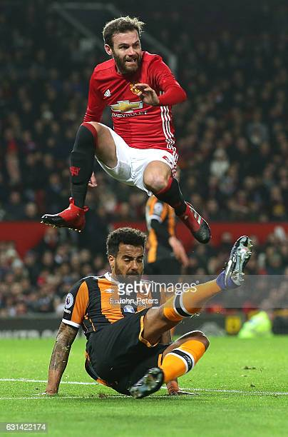 Juan Mata of Manchester United in action with Tom Huddlestone of Hull City during the EFL Cup SemiFinal first leg match between Manchester United and...
