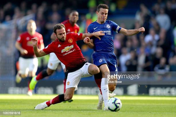 Juan Mata of Manchester United is challenged by Cesar Azpilicueta of Chelsea during the Premier League match between Chelsea FC and Manchester United...
