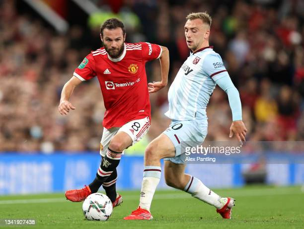 Juan Mata of Manchester United is challenged by Jarrod Bowen of West Ham United during the Carabao Cup Third Round match between Manchester United...