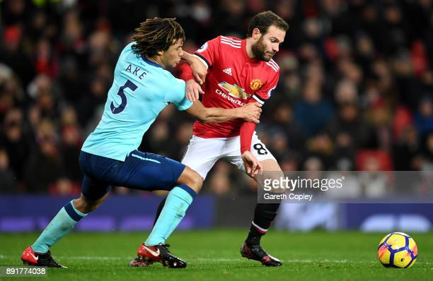 Juan Mata of Manchester United is challenged by Nathan Ake of AFC Bournemouth during the Premier League match between Manchester United and AFC...