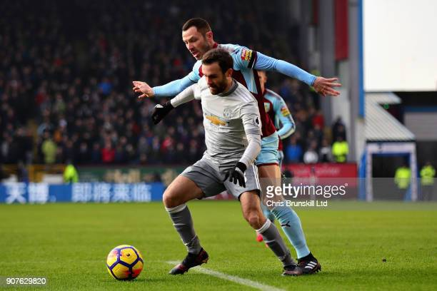 Juan Mata of Manchester United is challenged by Phil Bardsley of Burnley during the Premier League match between Burnley and Manchester United at...